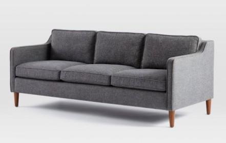 Szara sofa w stylu skandynawskim